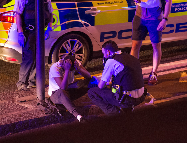 Man plows van into crowd by London mosque; 10 injured