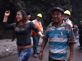 Entire families buried after volcano eruption
